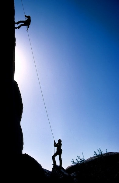 silhouette of climbers