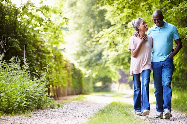 couple walking on a park trail, having a heart to heart